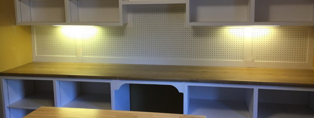 Shelves for a craft room custom built with pegboard and work table